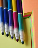 Colored pen over colored paper. Colorful pencils over colored peaces of paper stock photography