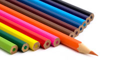 Colored pencil. Twelve lumpy coloured pencil. One sharp royalty free stock images