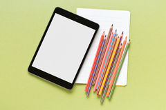 Colored pencil , blank notebook and computer tablet Royalty Free Stock Photography
