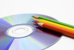 Colored pencil and CD Stock Images