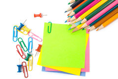 Colored pencil, clips and note Royalty Free Stock Image