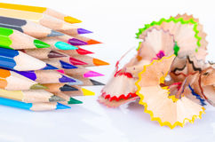 Colored pencil with colorful pencil shavings. Royalty Free Stock Photo