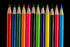 Colored Pencil Crayons. On black background Stock Image