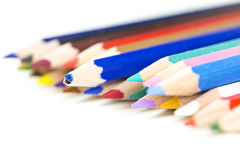Colored pencil crayons with focus to a broken one Royalty Free Stock Image