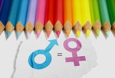 Colored pencil with equality of gender symbol in the white paper. Equality gender concept stock images