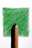 Colored pencil on green. Colored pencil on a green square drawn in pencil Stock Photo