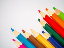 Colored pencil isolated on grey art paper. Colored pencil isolated on grey textured art paper arranged at the corner Stock Image