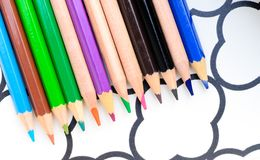colored pencil laying on paper Royalty Free Stock Images