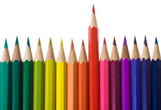 Colored pencil in a line composition set with red over isolated on white Royalty Free Stock Photography