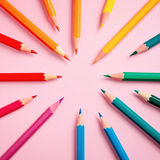 Colored pencil on pink paper background for drawing color circle Royalty Free Stock Photography