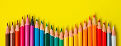Colored pencil rainbow wave art school education. In yellow background copy space stock photo