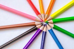 Colored pencil rays on white background. Set of colored pencils isolated against the white background. Rays of pencils. top view Royalty Free Stock Photos