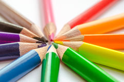 Colored pencil rays on white background. Set of colored pencils isolated against the white background. Rays of pencils. top view Stock Photo