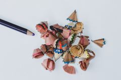 Colored pencil and sawdust caused by a pencil sharpener on the White Blackground.  stock images