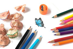 Colored pencil sharpening and butterfly drawing stock images