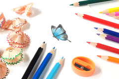 Colored pencil sharpening and butterfly drawing royalty free stock photos