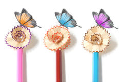 Colored pencil sharpening and butterfly drawing stock photos