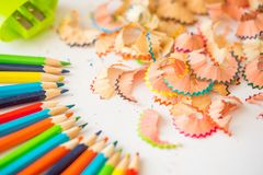 Colored pencil shaving on white background. school education concept.  stock photography