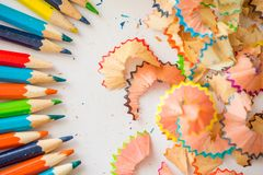 Colored pencil shaving on white background. school education concept.  stock image