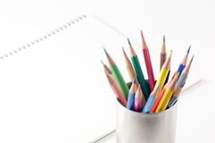 Colored pencil and sketchbook Royalty Free Stock Photos