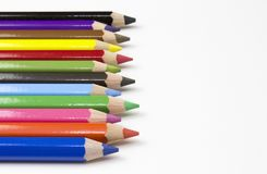 Color pencils on white background. Free royalty images. A colored pencil US-English, coloured pencil UK-English, Canada-English, pencil crayon Canada-English stock image
