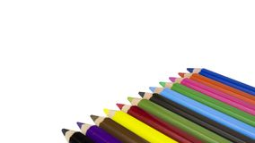 Color pencils on white background. Free royalty images. A colored pencil US-English, coloured pencil UK-English, Canada-English, pencil crayon Canada-English stock photos