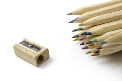 Colorful pencils and sharpener. Free royalty images. A colored pencil US-English, coloured pencil UK-English, Canada-English, pencil crayon Canada-English, lead royalty free stock image