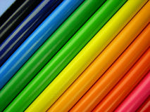 Colored Pencils. A  rainbow background of colored pencils arranged diagonally Royalty Free Stock Images