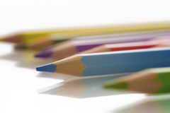 Colored pencils. Close up of colored pencils. Shallow depth of field. White background Royalty Free Stock Photography