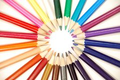 Colored pencils. Multicolored various pencils as an abstract sun rays royalty free stock photography