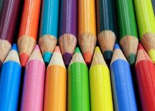 Colored pencils. Close up of colored pencils lined in rows Stock Image