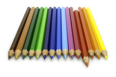 Colored Pencils. Neatly lined up with a red one sticking out Stock Photos