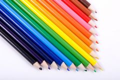 Colored Pencils. Lined up in an arrow arrangement stock photo