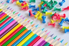 Colored pencils. Set of colored pencils and drawing pins Stock Photography