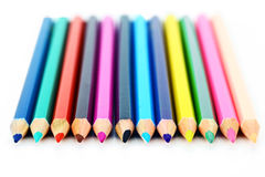 Colored pencils. Crayons on a white background Stock Photos