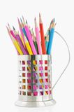 Colored pencils. In cup holders against white background Royalty Free Stock Photo