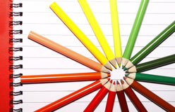 Colored Pencils. Lots of colored school art pencils on note pad paper Royalty Free Stock Images