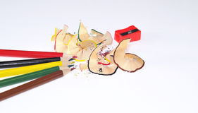 Colored pencils. Colored pencils with a sharpener isolated Stock Images