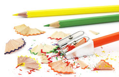 Colored pencils. And sharpener on white Stock Image