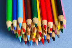 Colored pencils. With blue background Stock Images