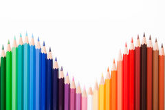 Colored pencils. In wave position Stock Images