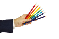 Colored pencils. Hand with colored pencils background Stock Photography