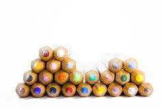Colored pencils. Front view of a set of isolated piled up wooden colored pencils. Selective focus Stock Photos