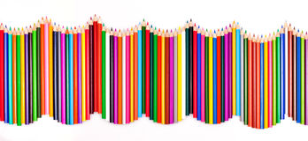 Colored pencils. Wave isolated on white background Royalty Free Stock Photography