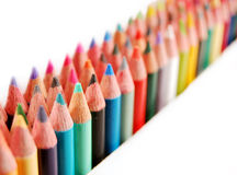 Colored Pencils. Rainbow  of colored pencils in rows on a white background Stock Images