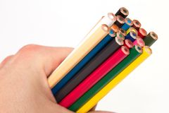 Colored pencils 2. Different colored pencils in a hand with a white background Royalty Free Stock Images