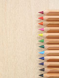Colored pencils. On wooden background Royalty Free Stock Photography