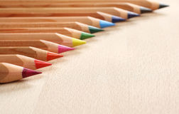 Colored pencils. On wooden background Royalty Free Stock Image