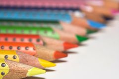 Colored pencils. Different coloured pencils with white background Royalty Free Stock Images