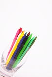Colored pencils. Kept in glass pot in angular position Stock Photography